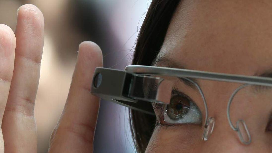 Woman demonstrates the Google Glass