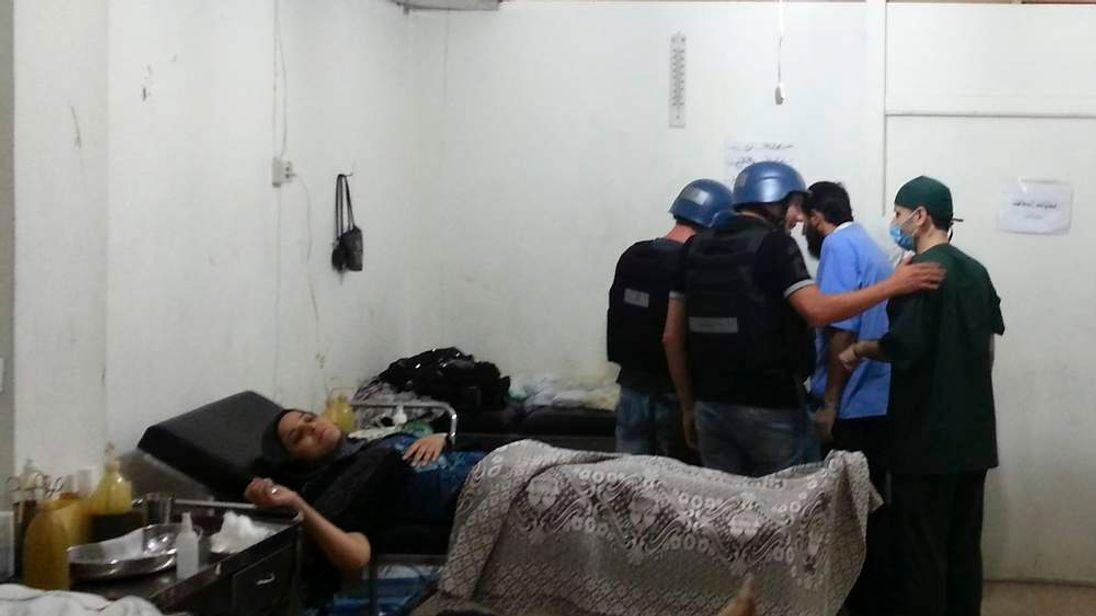 U.N. chemical weapons experts visit a hospital where wounded people affected by an apparent gas attack are being treated, in the southwestern Damascus suburb of Mouadamiya