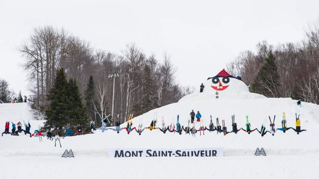 Thirty skiers perform a tandem backflip whilst holding hands in Quebec, Canada. Photo courtesy of Mont Saint-Sauveur International