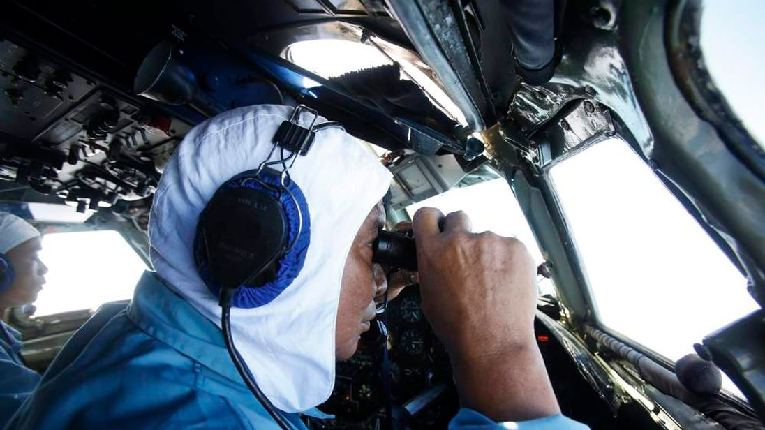 Deputy Commander of Vietnam 918 Air Brigade Senior Lieutenant Nguyen Tri Thuc looks out for the missing Malaysia Airlines flight MH370, off Con Dao island