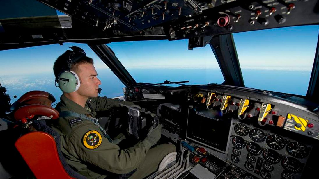 RAAF pilot, Flight Lieutenant Russell Adams from 10 Squadron, steers his AP-3C Orion over the Southern Indian Ocean during the search for missing Malaysian Airlines flight MH370
