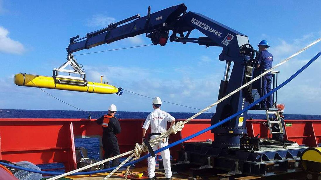 The Bluefin 21 is hoisted back on board the Australian Defence Vessel Ocean Shield after a successful buoyancy test in the southern Indian Ocean