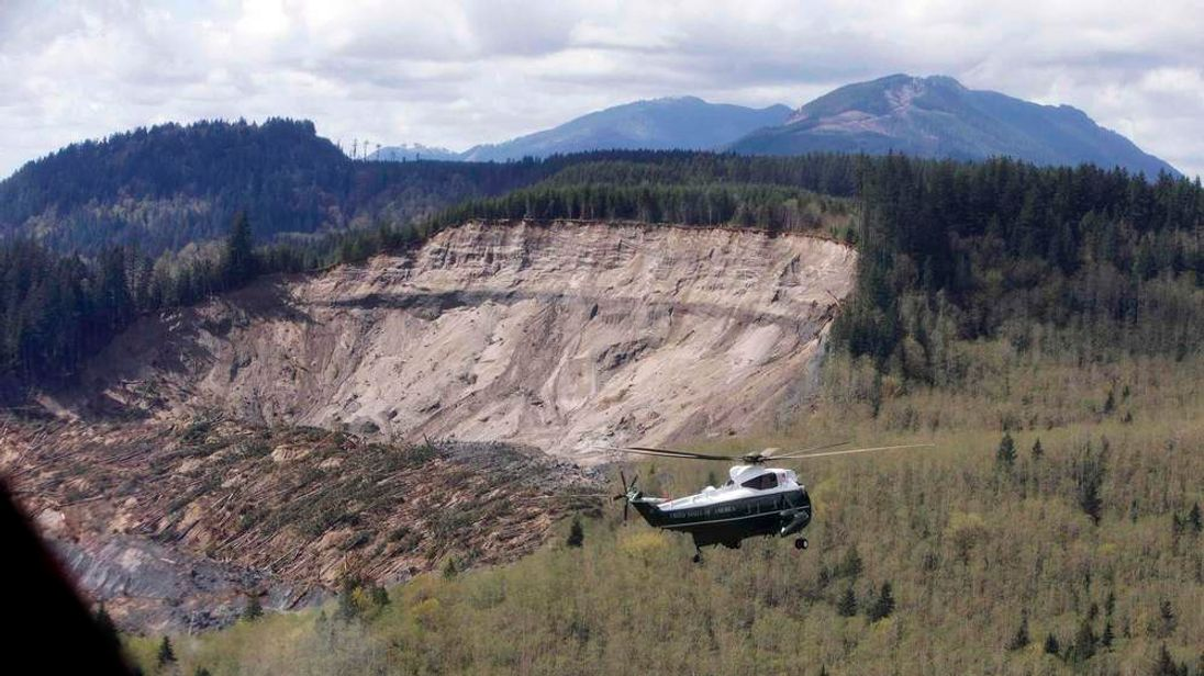 File photo of Marine One carrying U.S. President Barack Obama touring the mud slide damage in Oso