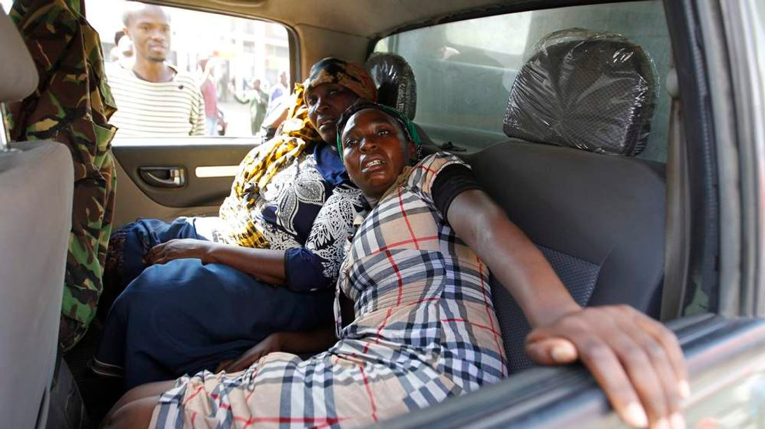 Traders, who were injured in a twin explosion, are evacuated from the scene at the Gikomba open-air market for second-hand clothes in Nairobi