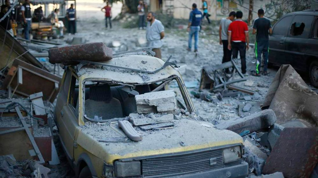 A car, which police said was damaged in an Israeli air strike that targeted the house of top Hamas political leader Mahmoud Zahar, is seen in Gaza City