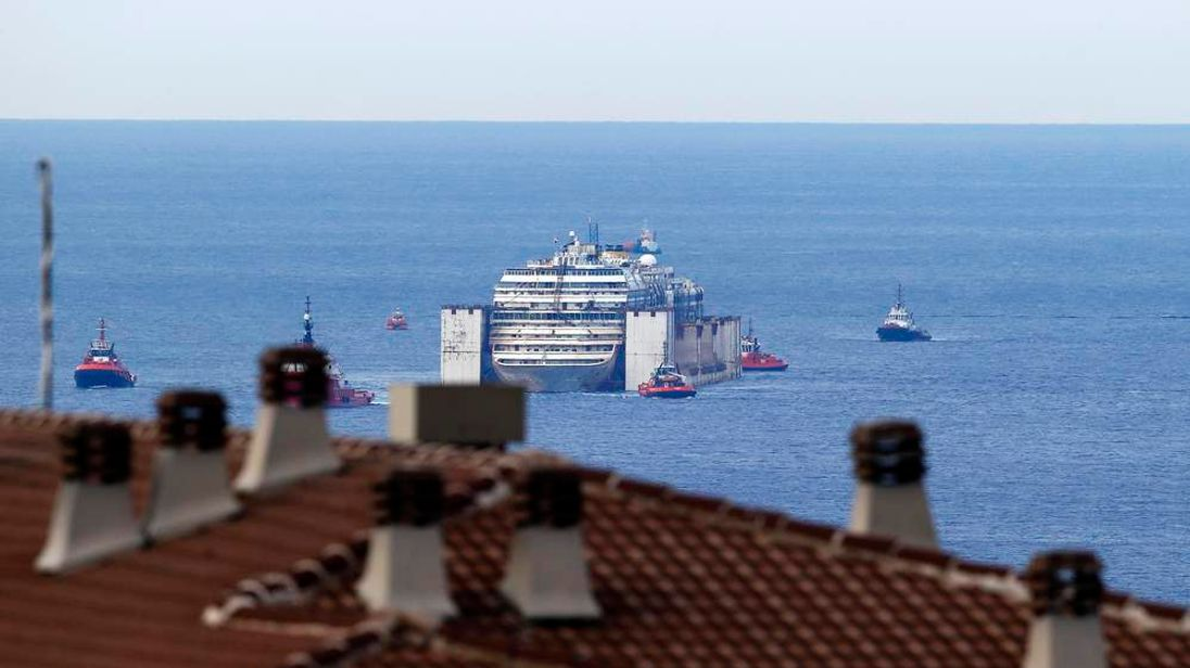 The Costa Concordia arrives at the port of Genoa to be scrapped.