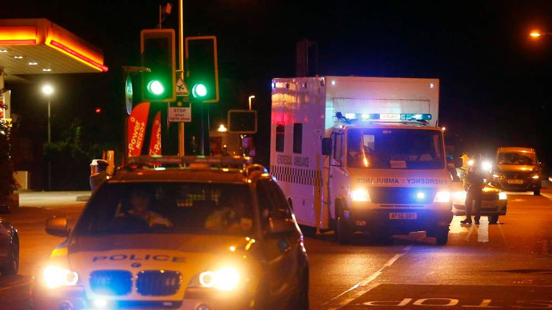 Police escort a RAF ambulance carrying a British man infected with ebola virus after he was flown home on a C17 plane from Sierra Leone, at Northolt air base outside London.