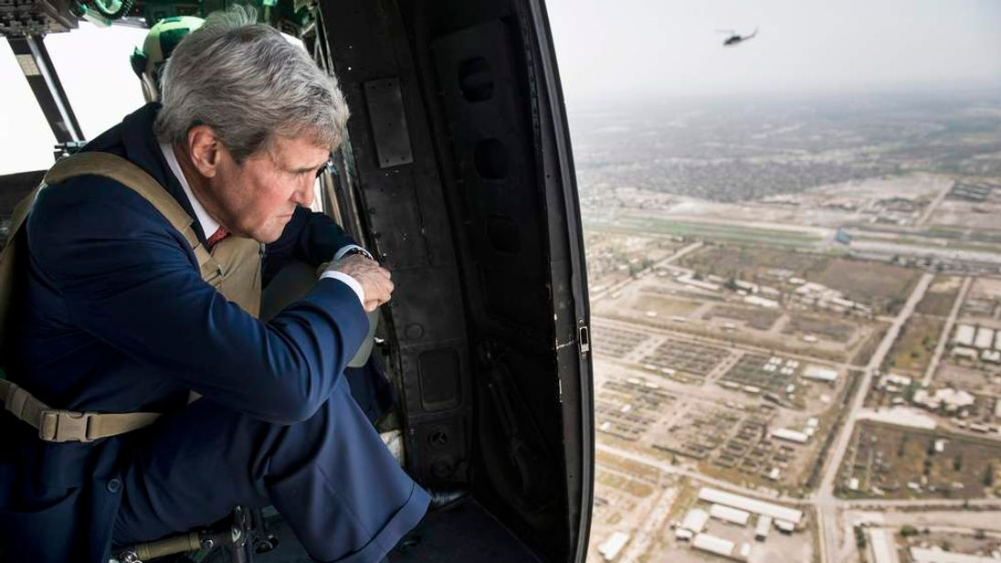U.S. Secretary of State Kerry looks out over Baghdad from a helicopter