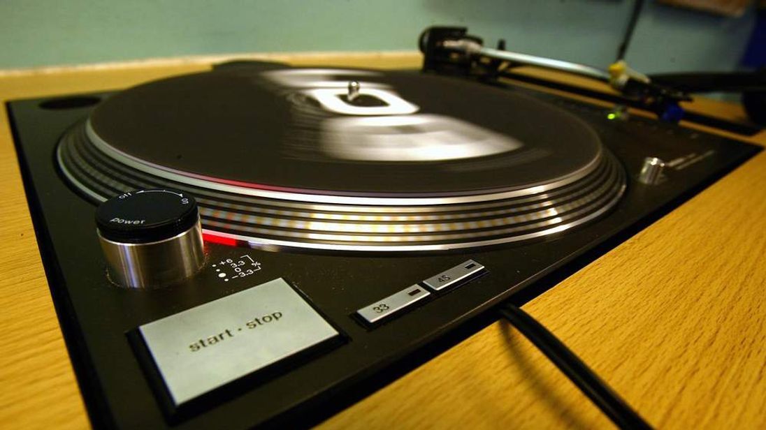 A turntable spins in a record shop in London