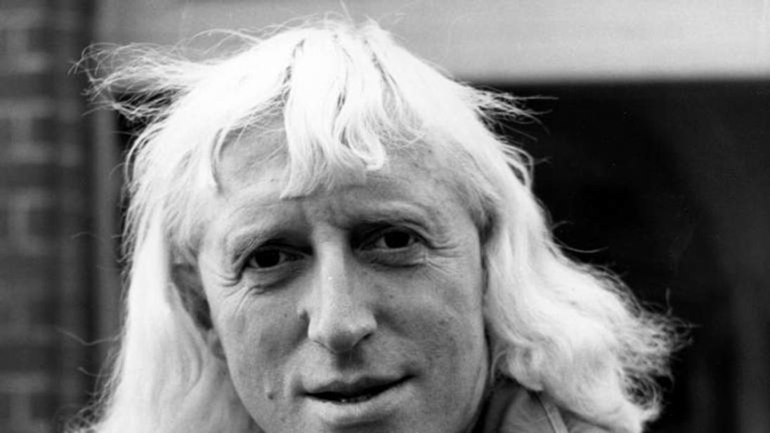 Jimmy Savile OBE, British disc jockey, television broadcaster and charity fundraiser.
