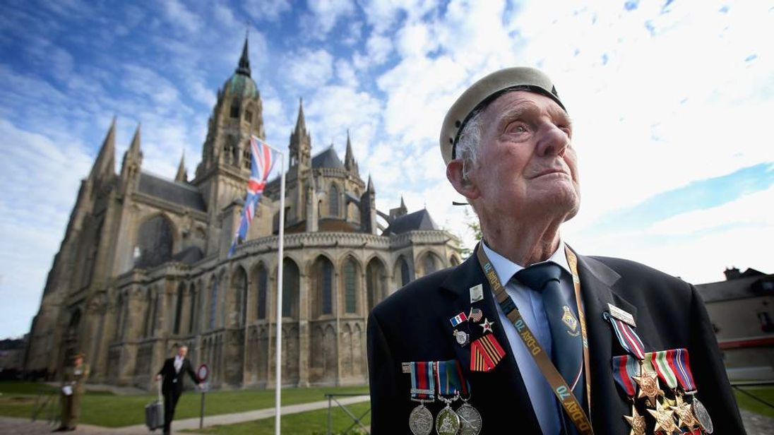 War veteran Victor Walker, 88, attends a memorial service at Bayeux Cathedral