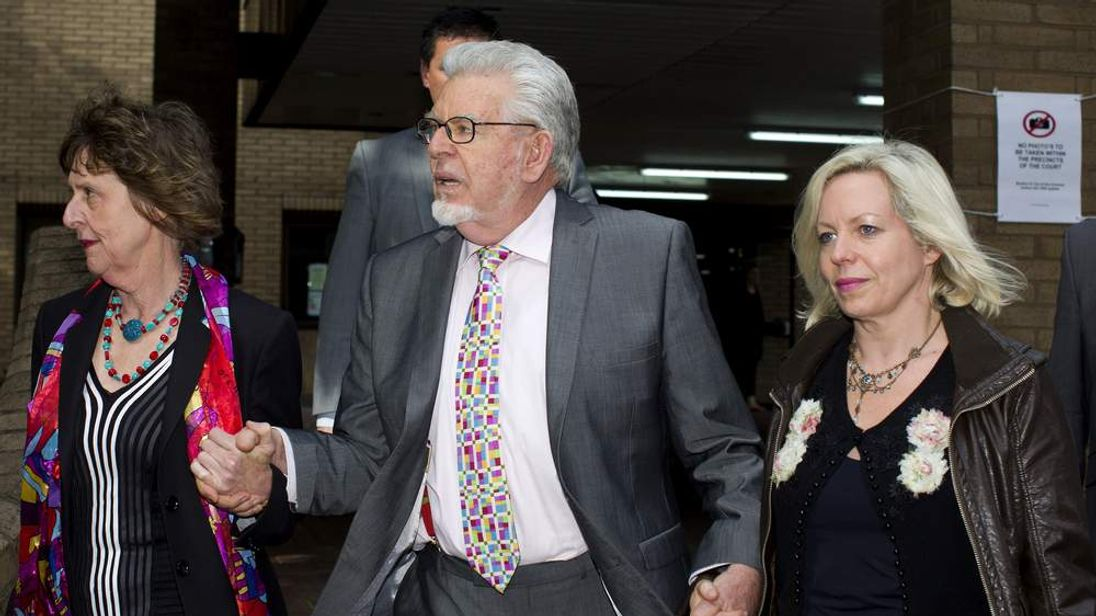 Rolf Harris (C) his niece Jenny (L) and daughter Bindi (R) leaving court