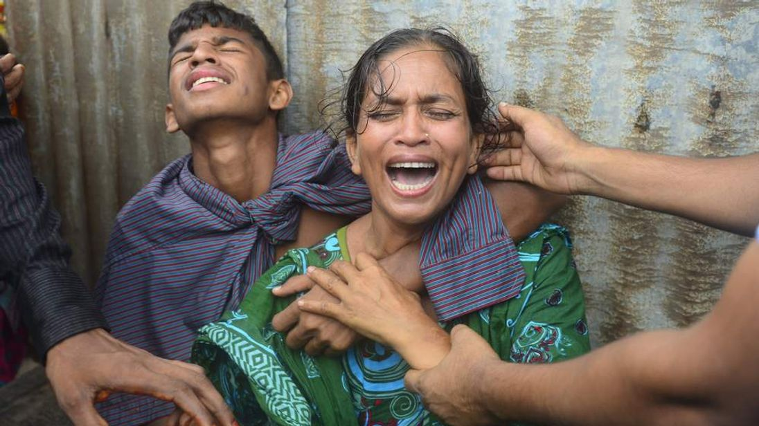 Bangladeshis mourn their missing relatives after a packed ferry capsized