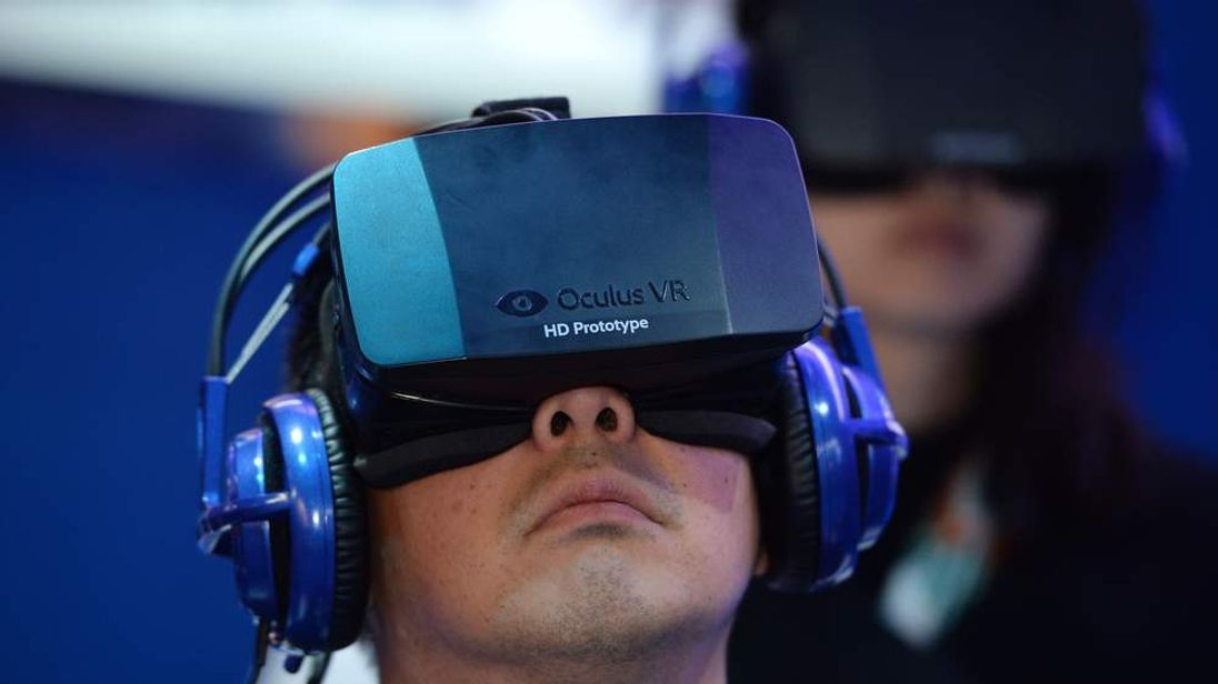 An Oculus headset is tried out at the CES show in Las Vegas in January, 2014.