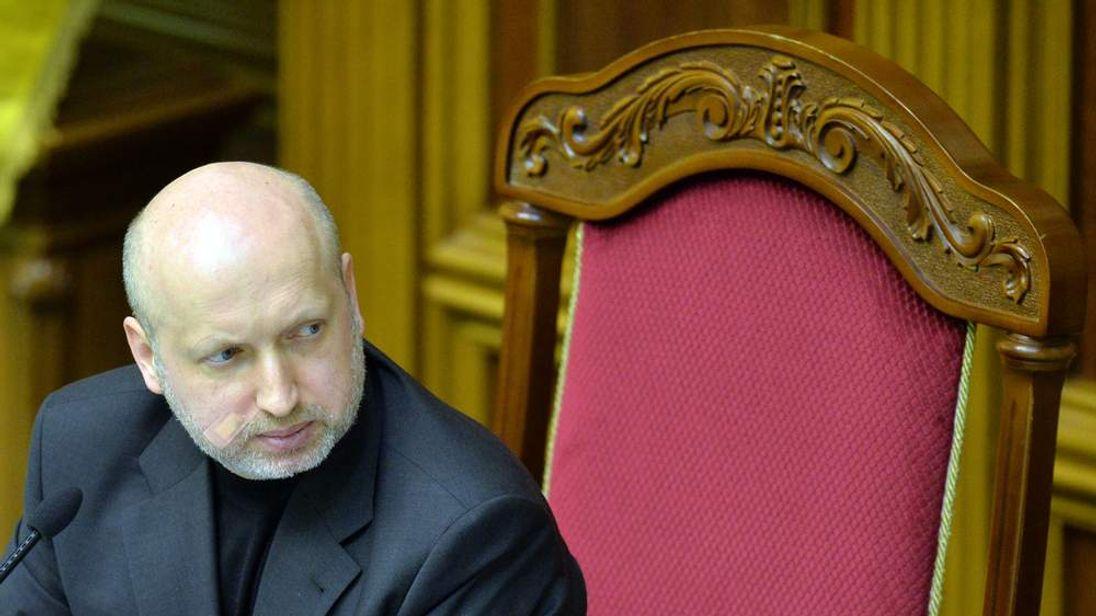 The acting president of Ukraine speaks in Parliament in Kiev.