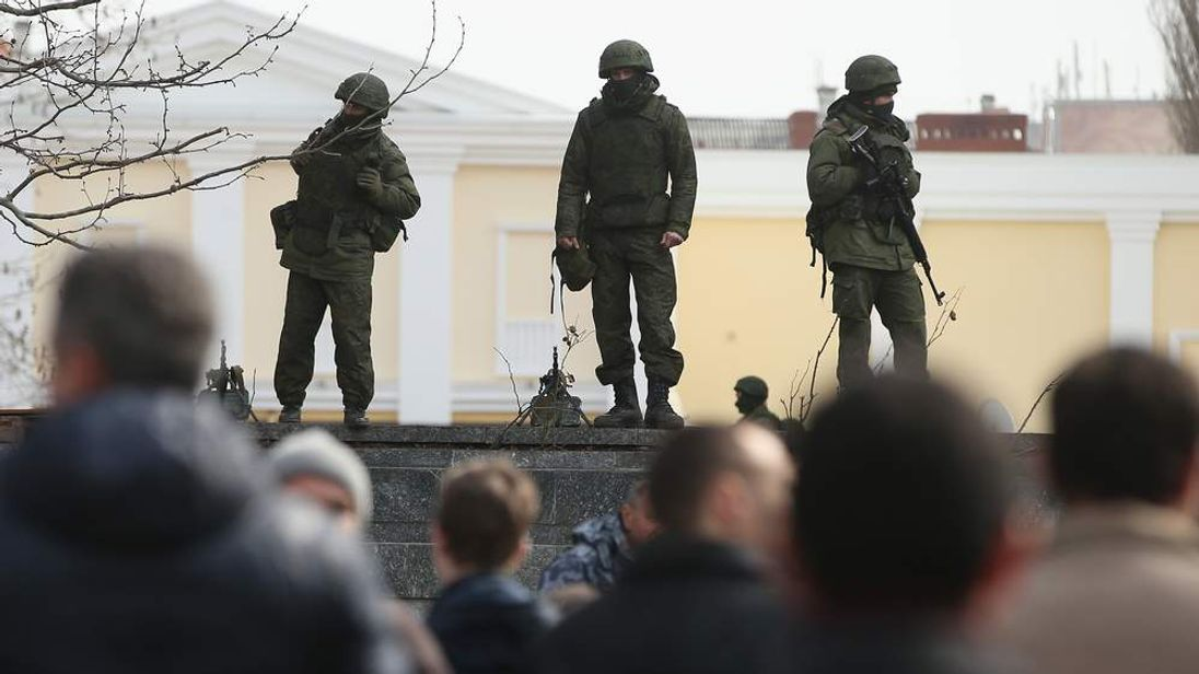 Unidentified but armed soldiers stand guard outside the Crimean parliament building in Ukraine.