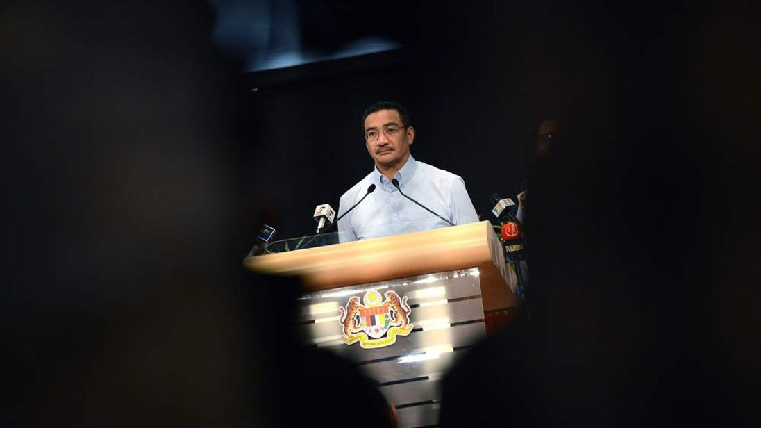 Malaysia's Acting Transport Minister Hishammuddin Hussein speaks at a press conference.