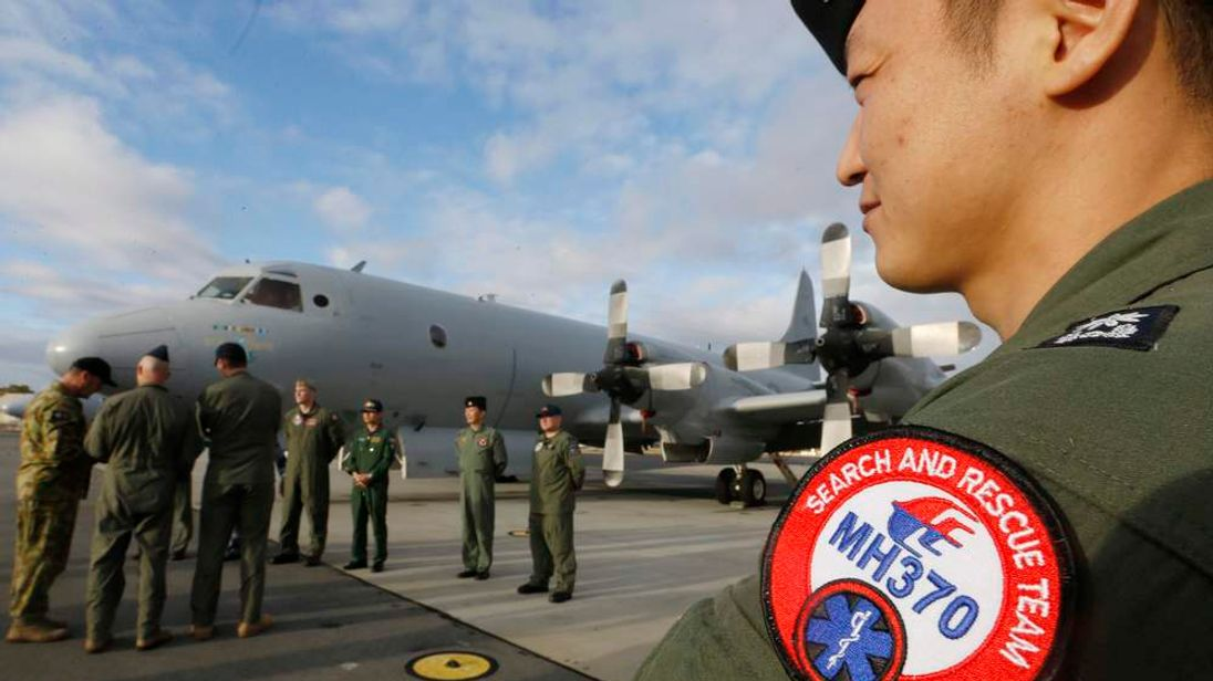 South Korean Navy Lieutenant Commander Oh Kang-Min is pictured wearing a MH370 search and rescue team patch on his sleeve as he waits to meet Australian Prime Minister Tony Abbott.