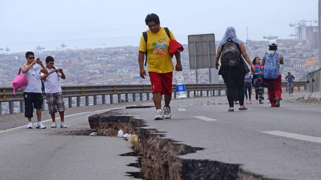 A cracked road in Iquique, northern Chile, after a powerful earthquake