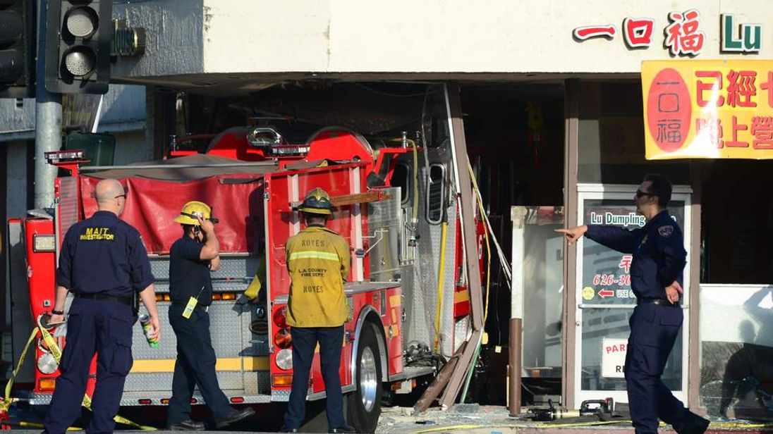 Paramedics and police survey the scene in Monterey Park, California, where two fire engines crashed into each other.