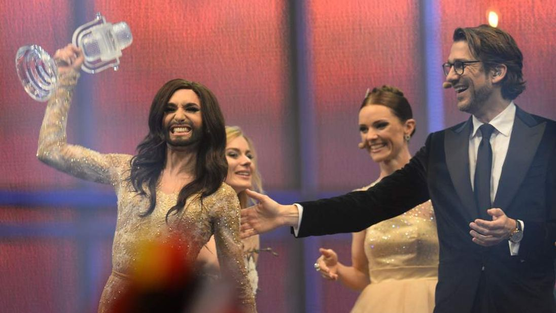 Conchita Wurst representing Austria reacts on stage with the trophy after winning the Eurovision Song Contest 2014 Grand Final in Copenhagen, Denmark.
