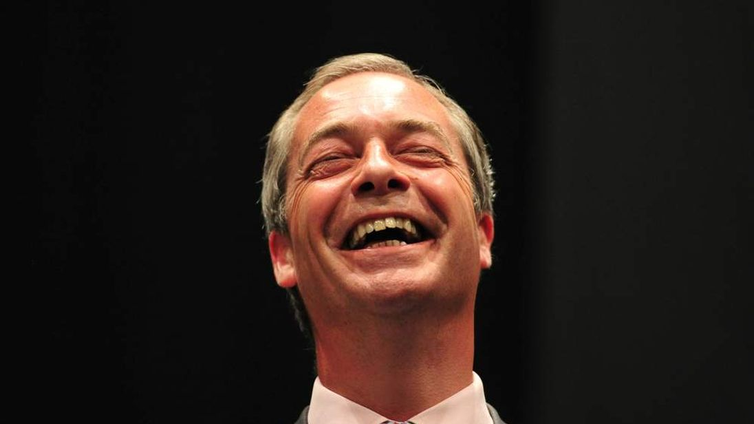 UKIP leader Nigel Farage reacts on stage after being re-elected as an MEP as the South East England.