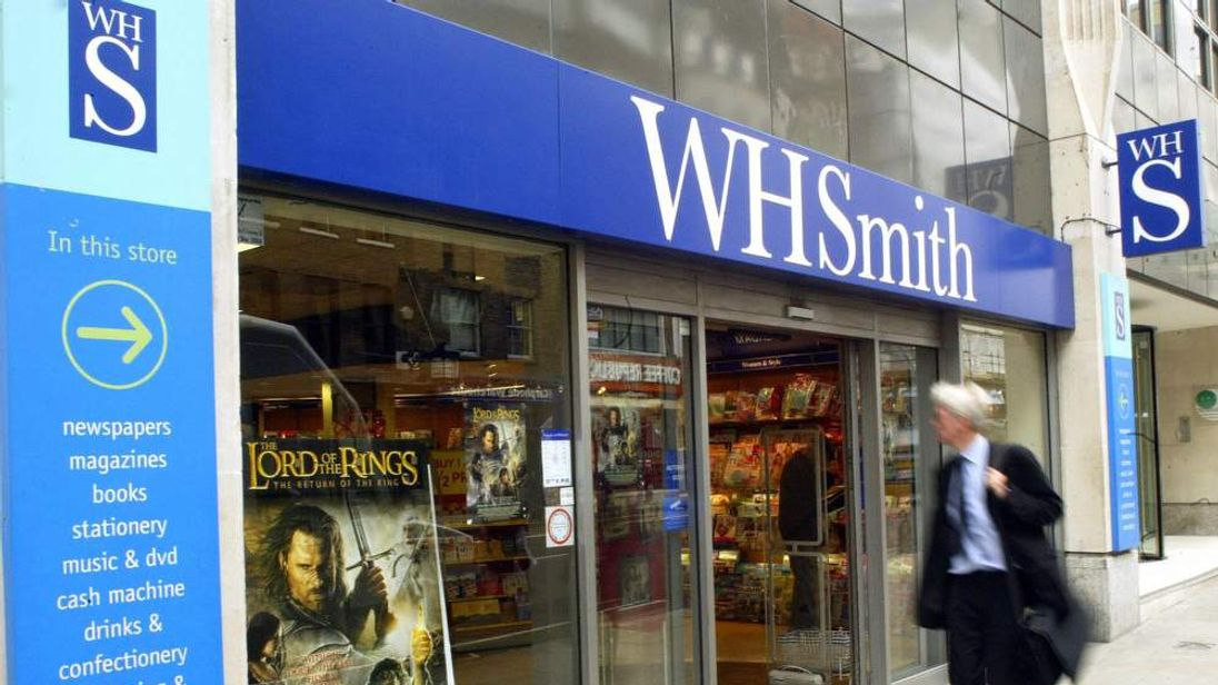 A pedestrian walks past the book seller WH Smith