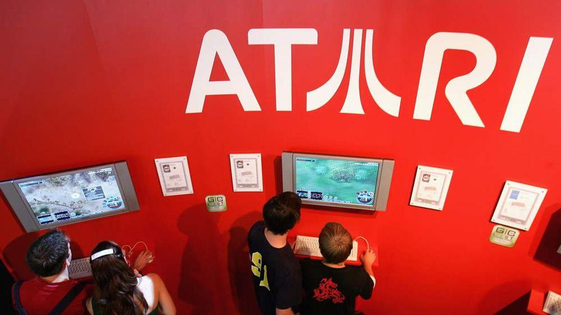 Visitors play Atari titles at a computer gaming convention in Leipzig