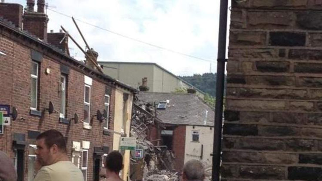 There are fears people may be trapped after homes were destroyed in a large suspected gas explosion in the Shaw area of Oldham, authorities say.