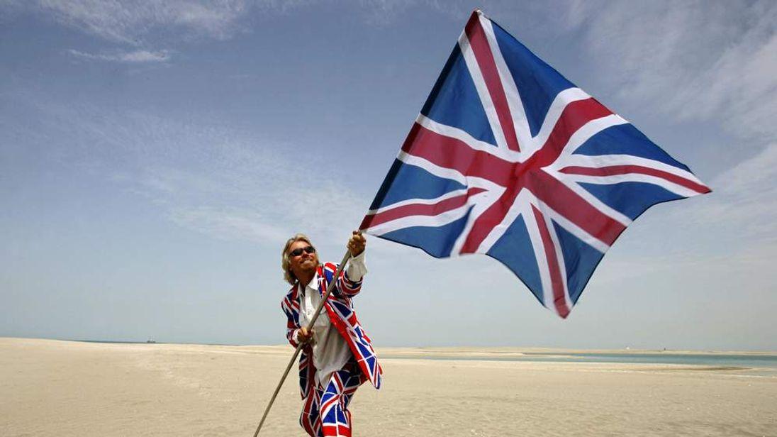 British entrepreneur Sir Richard Branson waves the Union flag