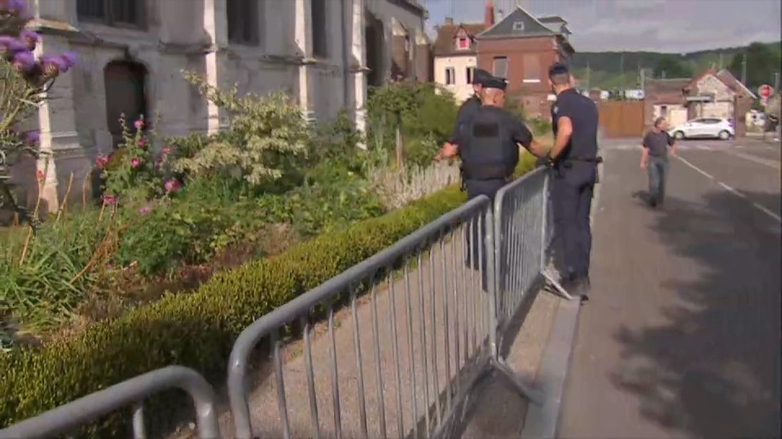 Sky's Nick Martin walks around the church in Normandy where the priest was killed
