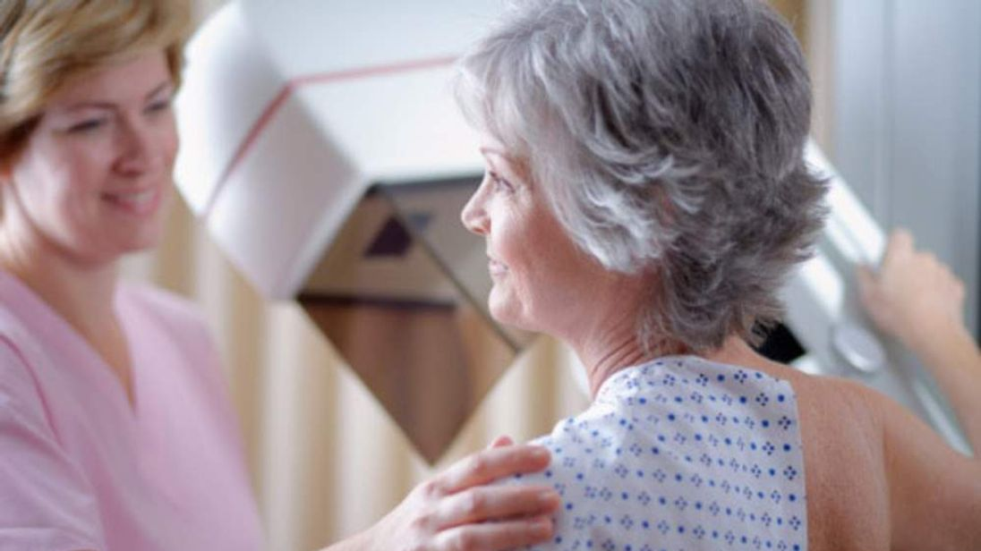 Woman Being Tested For Breast Cancer Using Mammogram