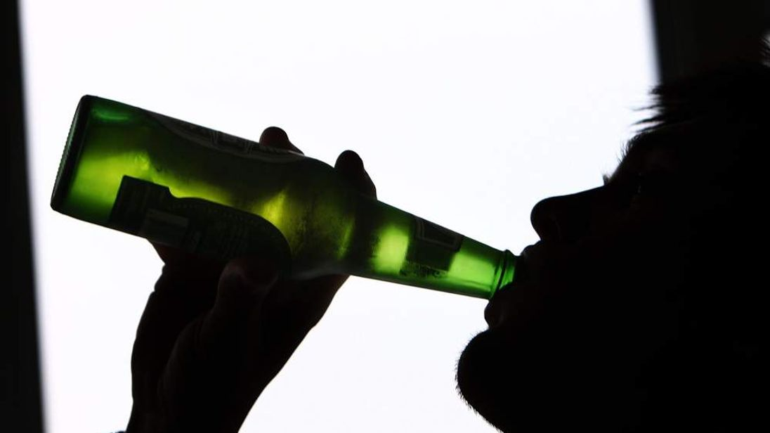 Person Drinking Bottle Of Beer Alcohol