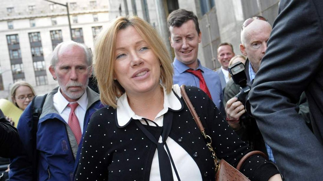 Anna Gristina exits Manhattan criminal court in New York on Tuesday, Sept. 25, 2012. The suburban mother of four charged with moonlighting as a multimillion-dollar madam pleaded guilty Tuesday to promoting prostitution.