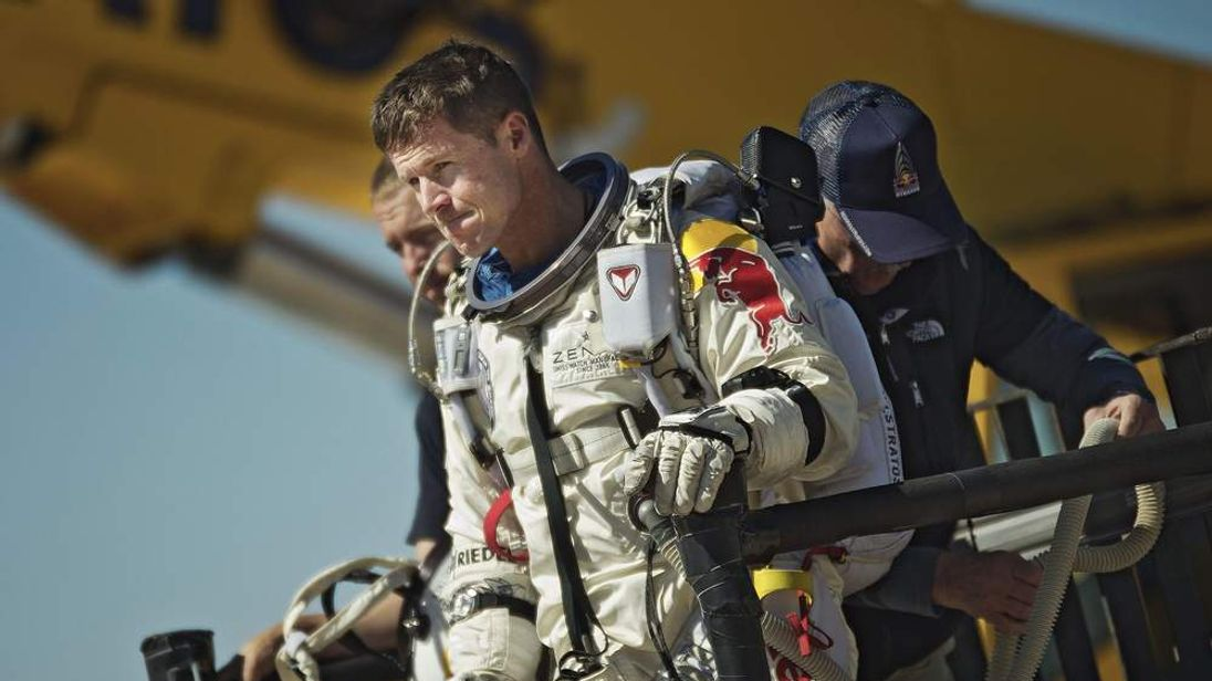 FILE - This photo provided by Red Bull Stratos shows pilot Felix Baumgartner of Austria reacting after his mission was aborted in Roswell, N.M., on Oct. 9, 2012.