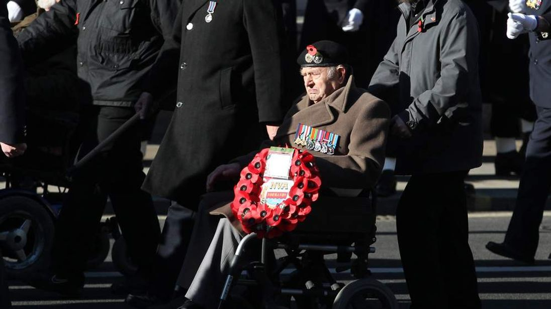 Veterans march at the Cenotaph memorial in London on Remembrance Sunday, in tribute to members of Britain and the Commonwealth's Armed Forces who have died during conflicts.