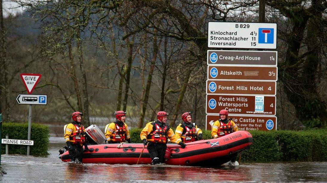 Firemen wade through Aberfoyle