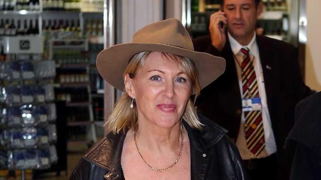 Nadine Dorries arrives at Heathrow