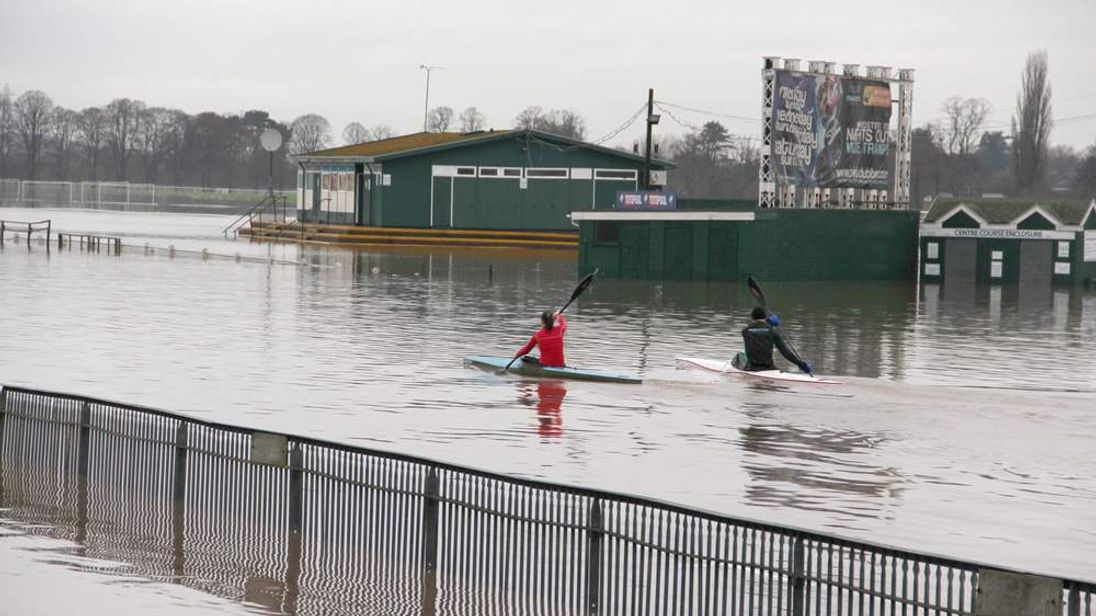 Kayakers train on a flooded Worcester Racecourse. PRESS ASSOCIATION Photo. Picture date: Saturday December 22, 2012.