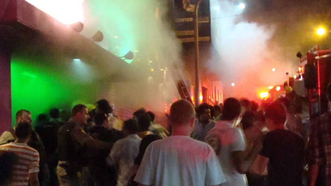 Crowds outside the nightclub as smoke pours out from inside