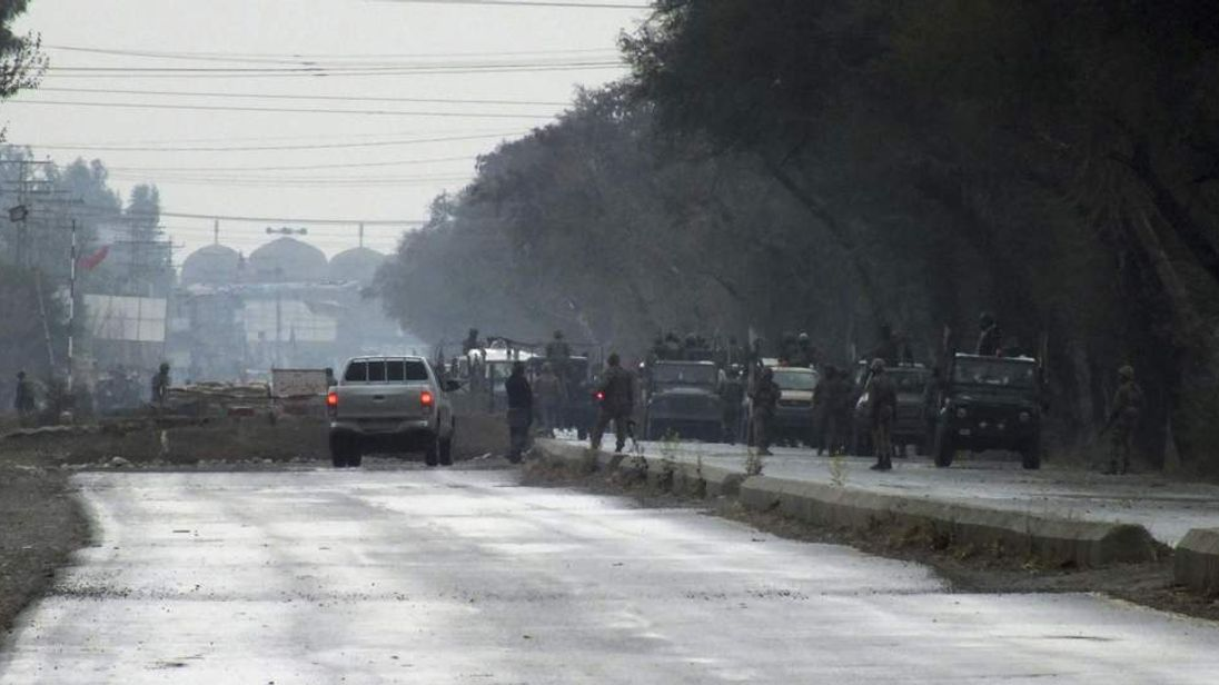 Pakistani army troops gather at the scene of a militant attack on Saturday