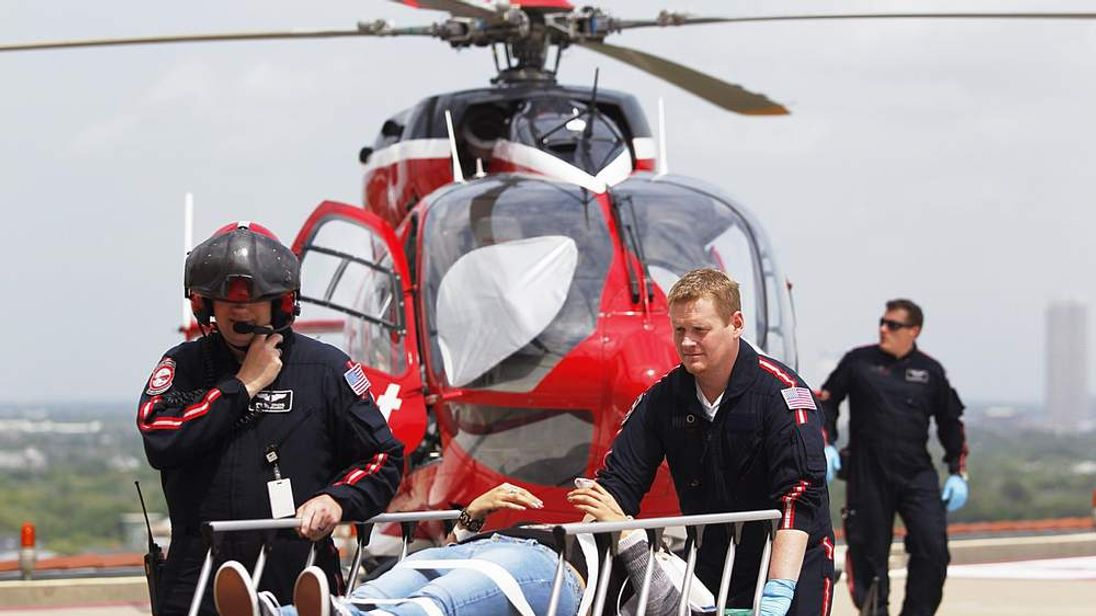 A victim is taken to hospital by helicopter