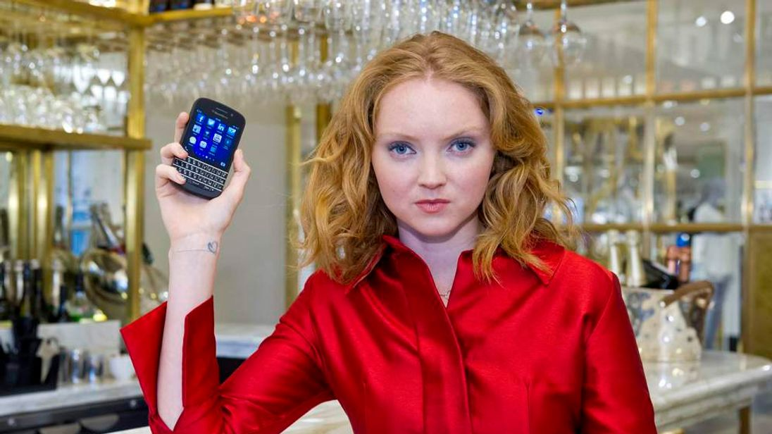 Lily Cole holds a BlackBerry Q10 ahead of its UK launch