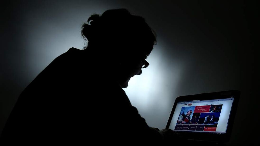 Computer user in shadow
