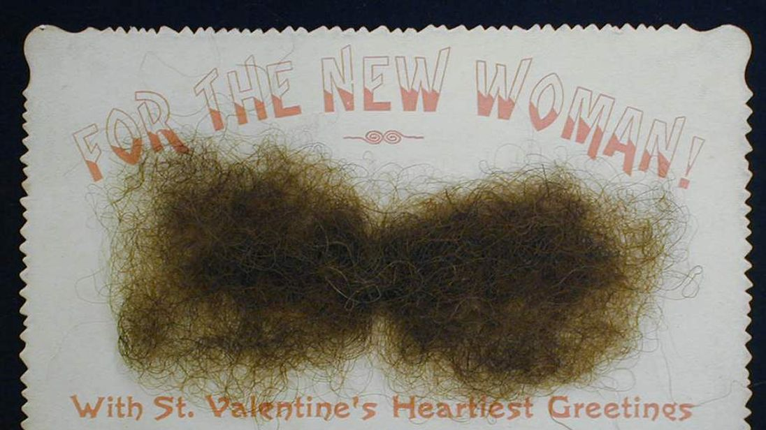 A Victorian Valentine's Day card including facial hair to resemble a moustache.