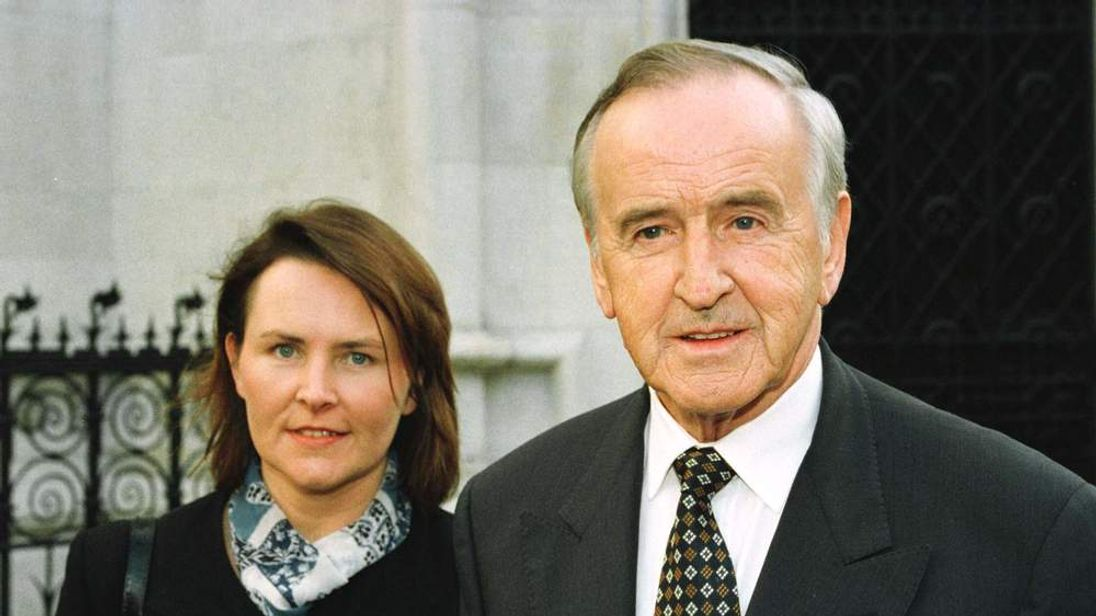 Former Irish premier Albert Reynolds, accompanied by daughter Miriam, arrives at the High Court Octo..