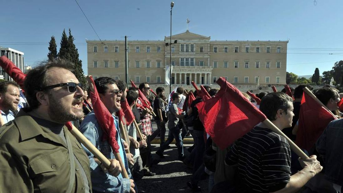 Protesters march in Athens