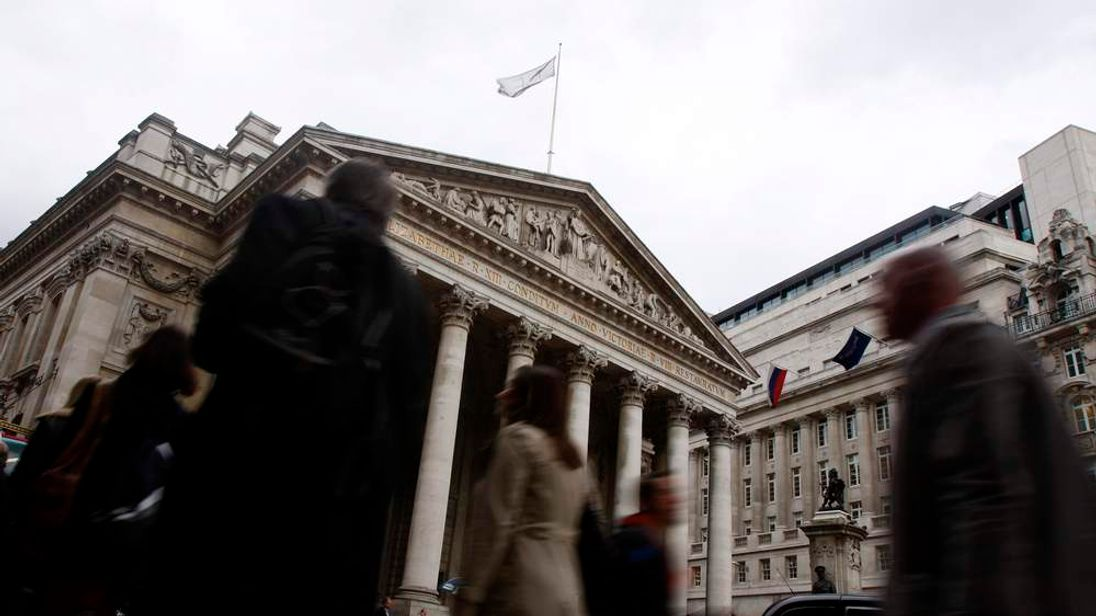 Commuters make their way home past the Bank of England