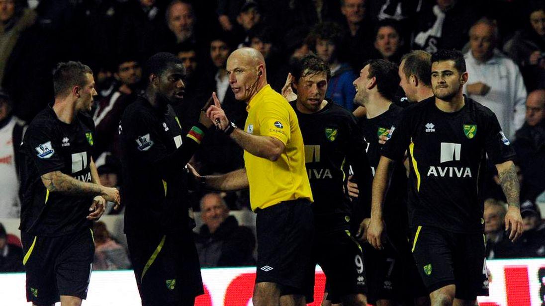 Norwich City's Sebastien Bassong speaks to referee Howard Webb