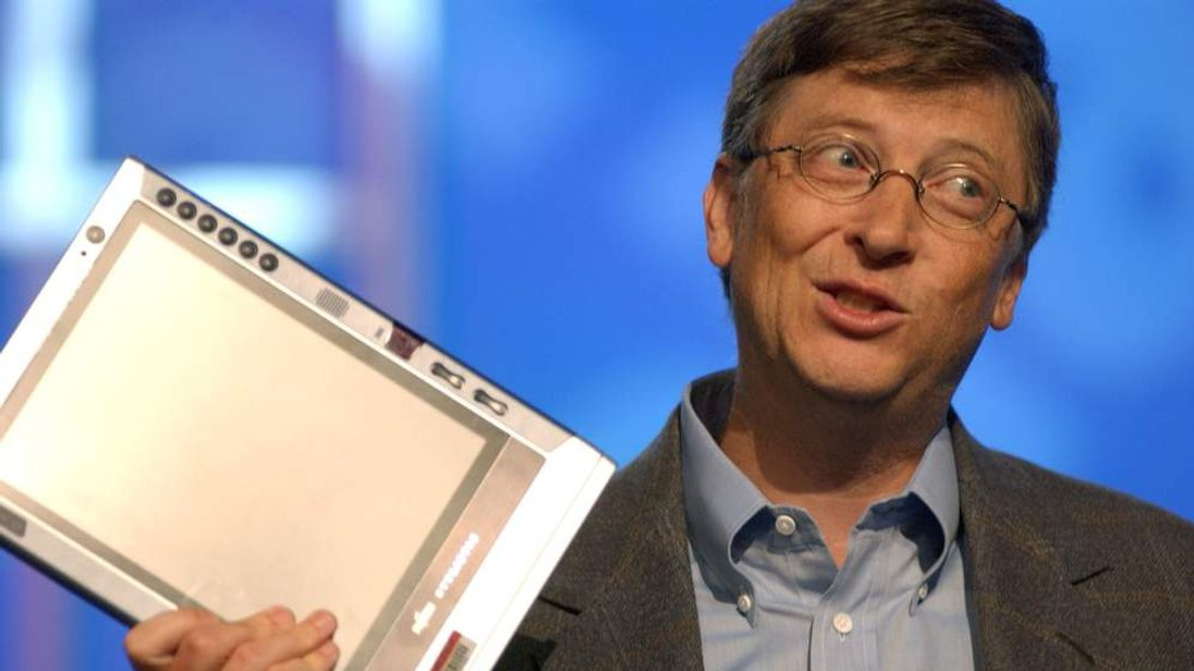 Microsoft Chairman Bill Gates holds a tablet PC as he speaks about newspapers and technology at the annual Newspaper Association of America's convention April 29, 2003 in Seattle, Washington